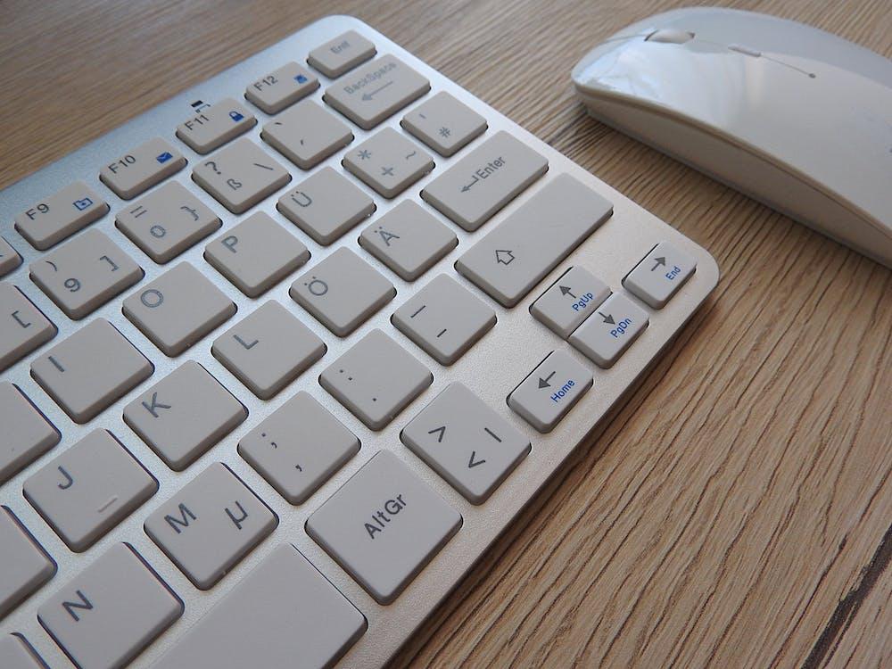 Apple Wireless Keyboard Beside Apple Magic Mouse