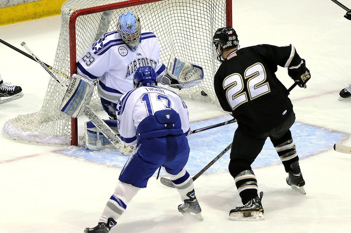 Hockeyspieler, Die Hockey Spielen
