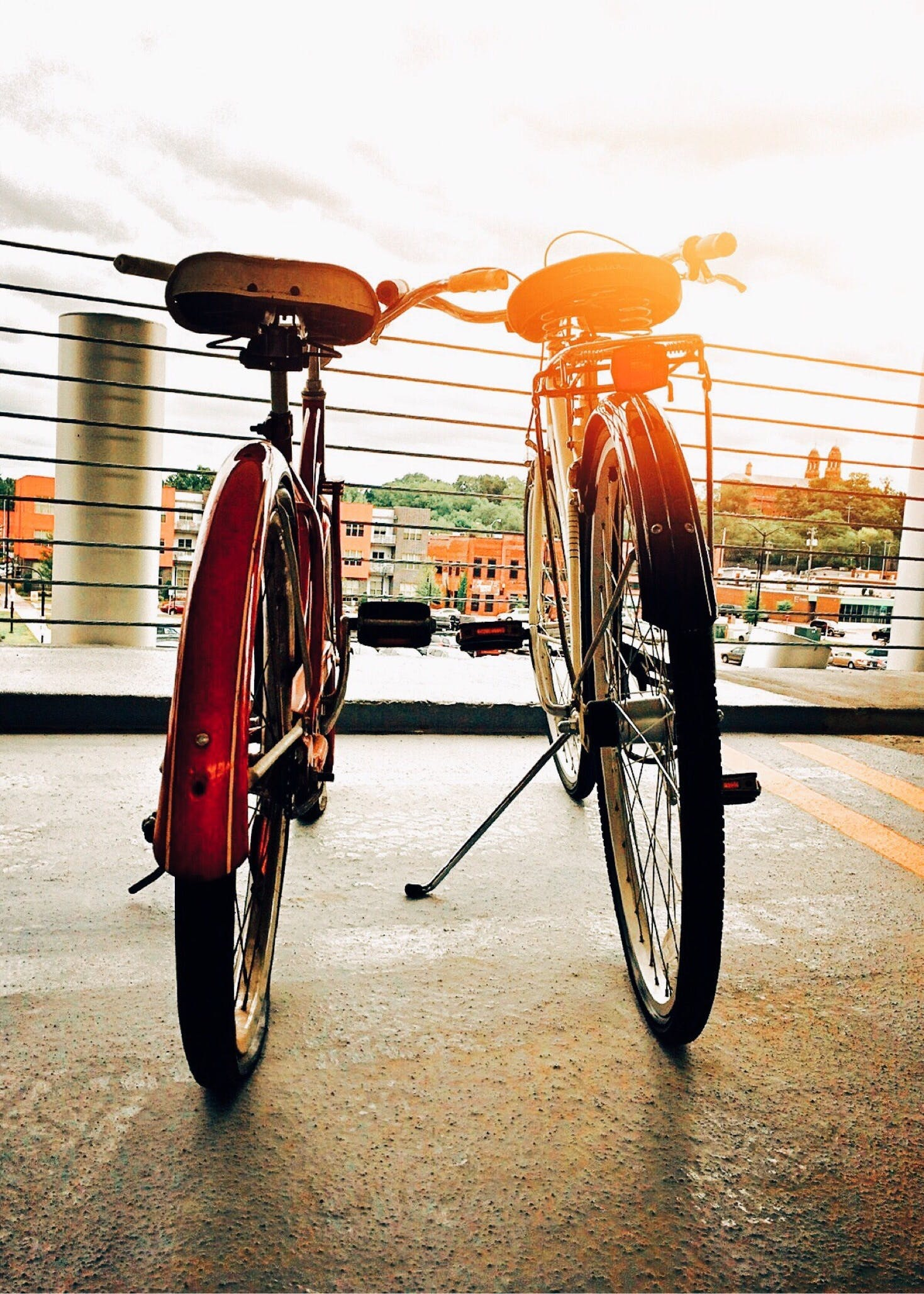Two Bicycles Parked Upright