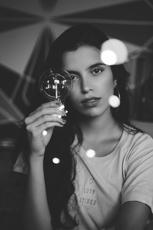 Photo of Woman Holding Light Bulb