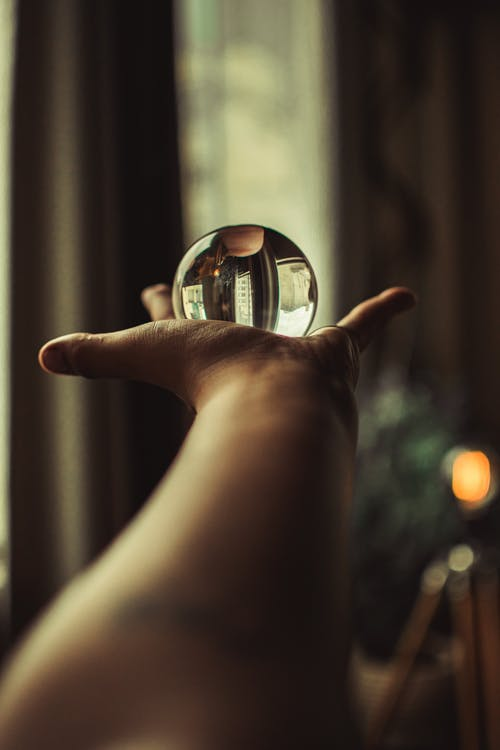 Person Holding Waterglobe