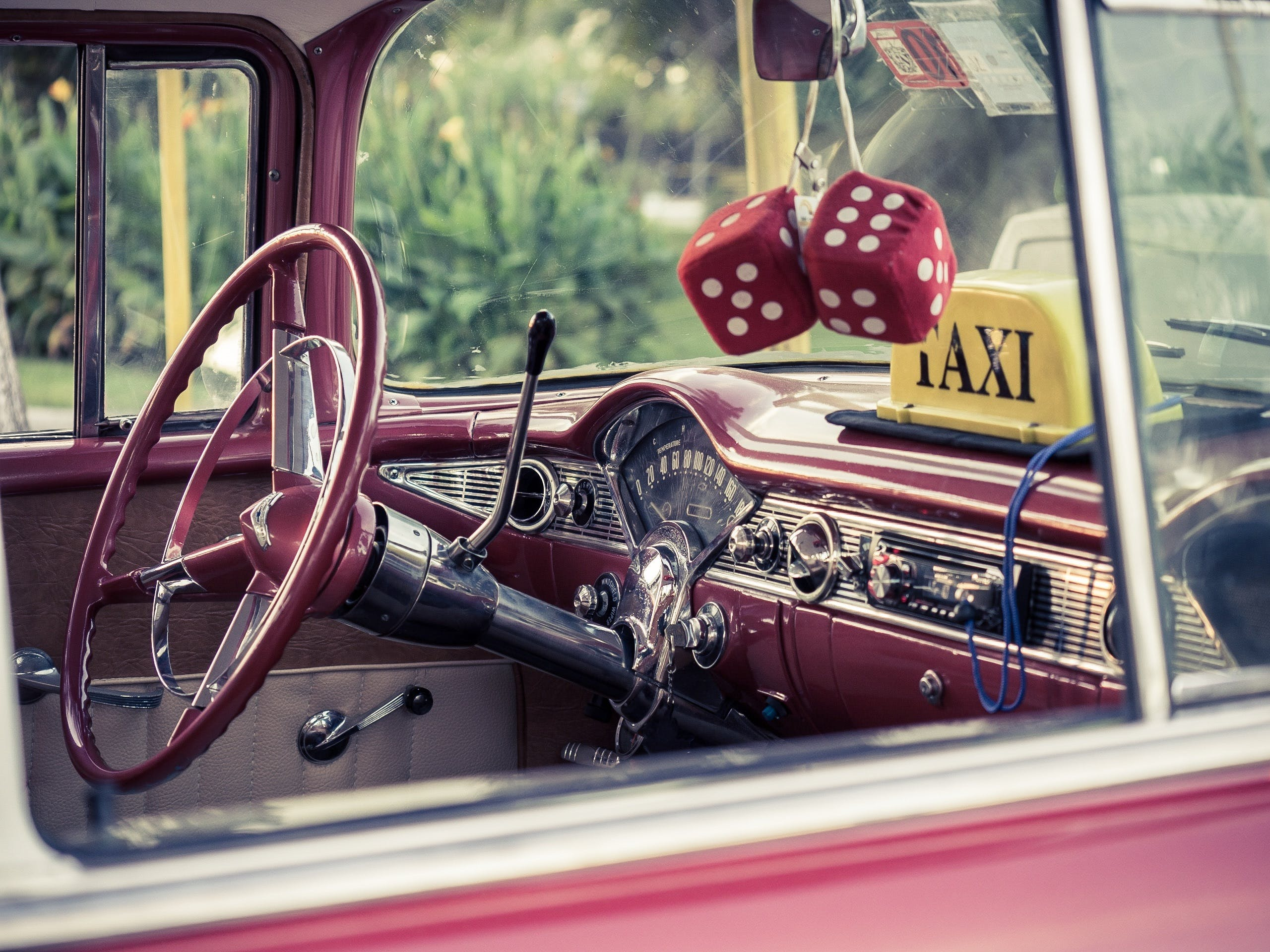 Selective Focus Photography of Red Vehicle Interior