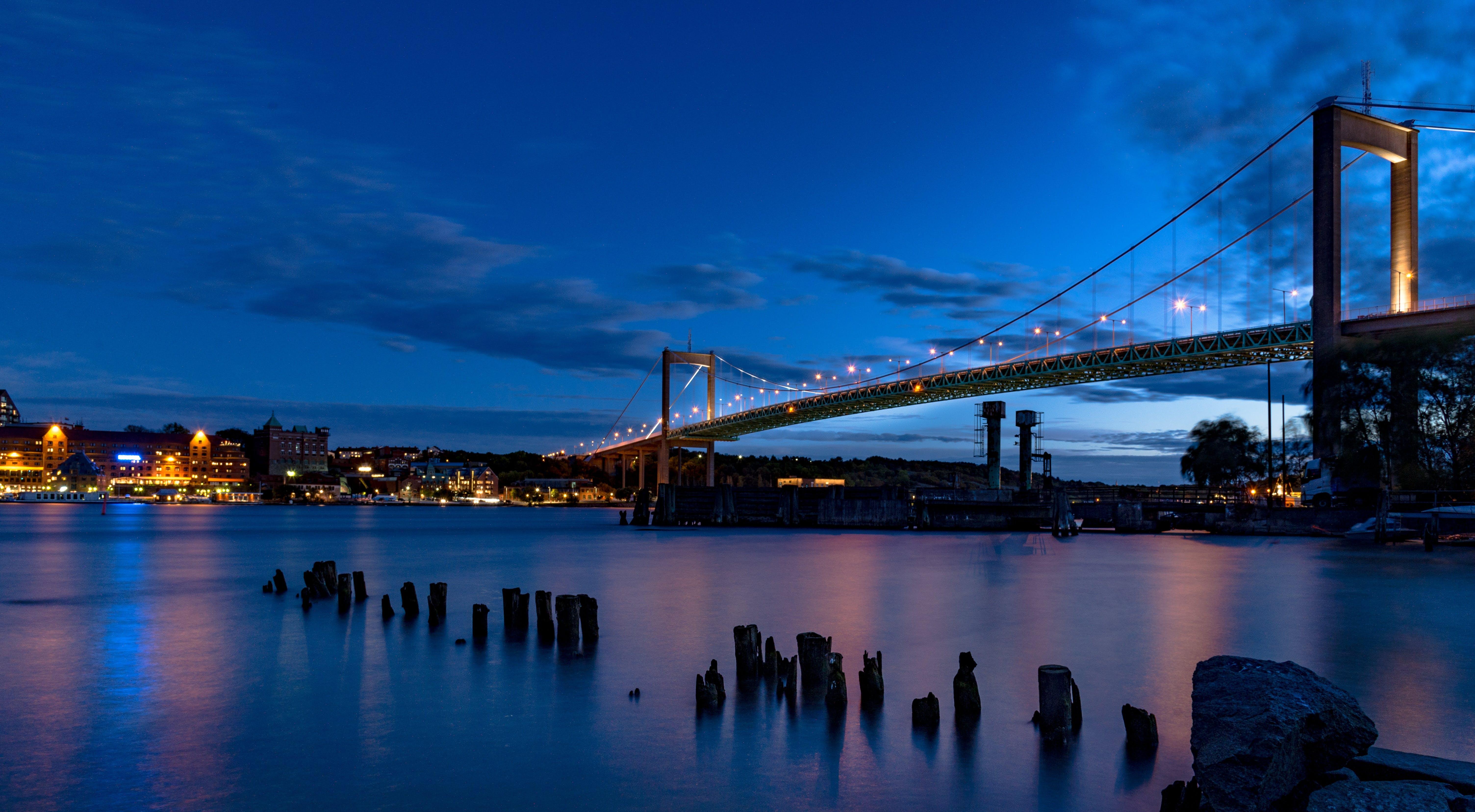 View of Body of Water Below City Suspension Bridge