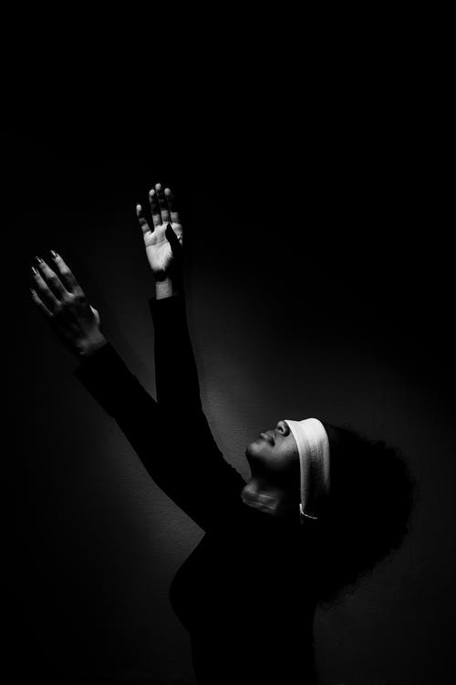 Woman With Blindfold Raising Her Two Hands