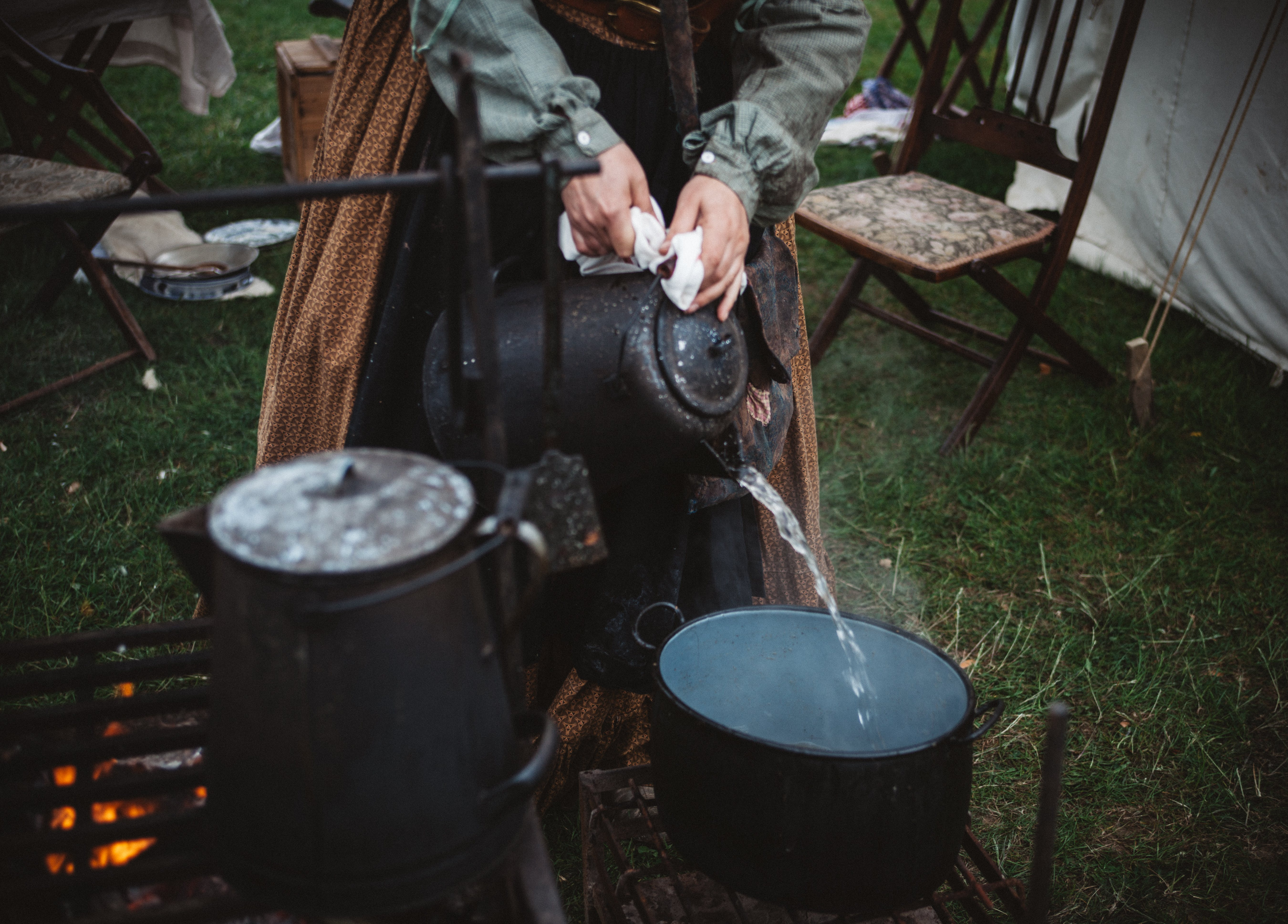 Person Pouring Water on Cooking Pot