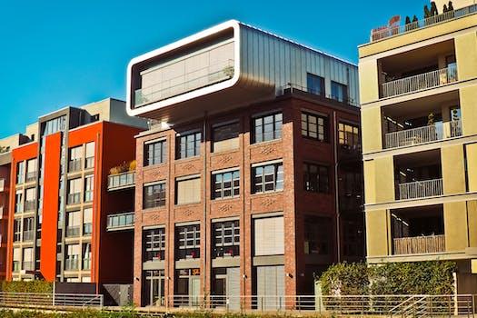 modern building against sky free stock photo. Black Bedroom Furniture Sets. Home Design Ideas