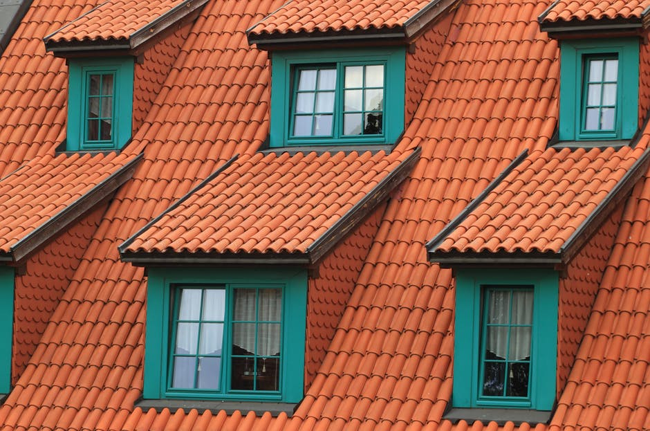 Orange Shingles on Green House