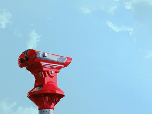 Red Theodolite Under Blue Sky and White Clouds