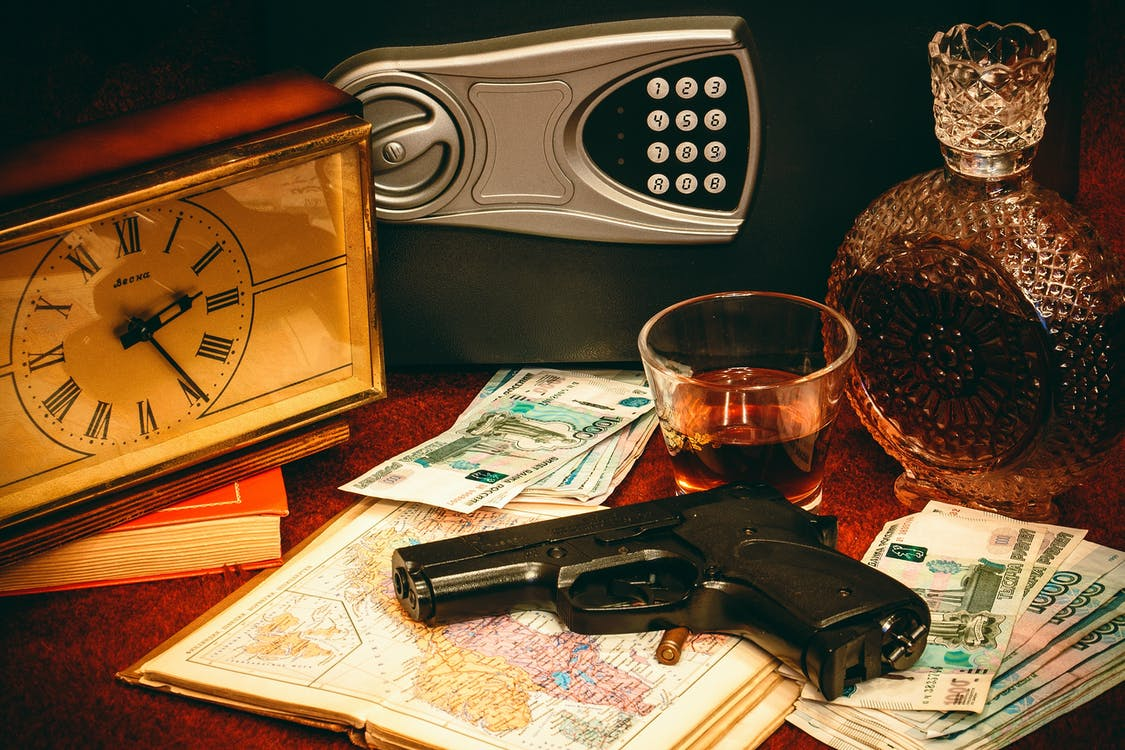 Gun and Vault on Table