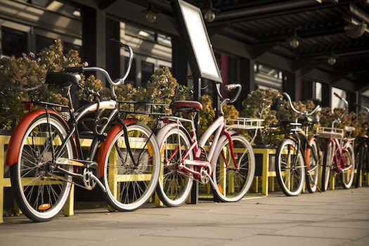Free stock photo of bikes, pavement, bicycles, parked
