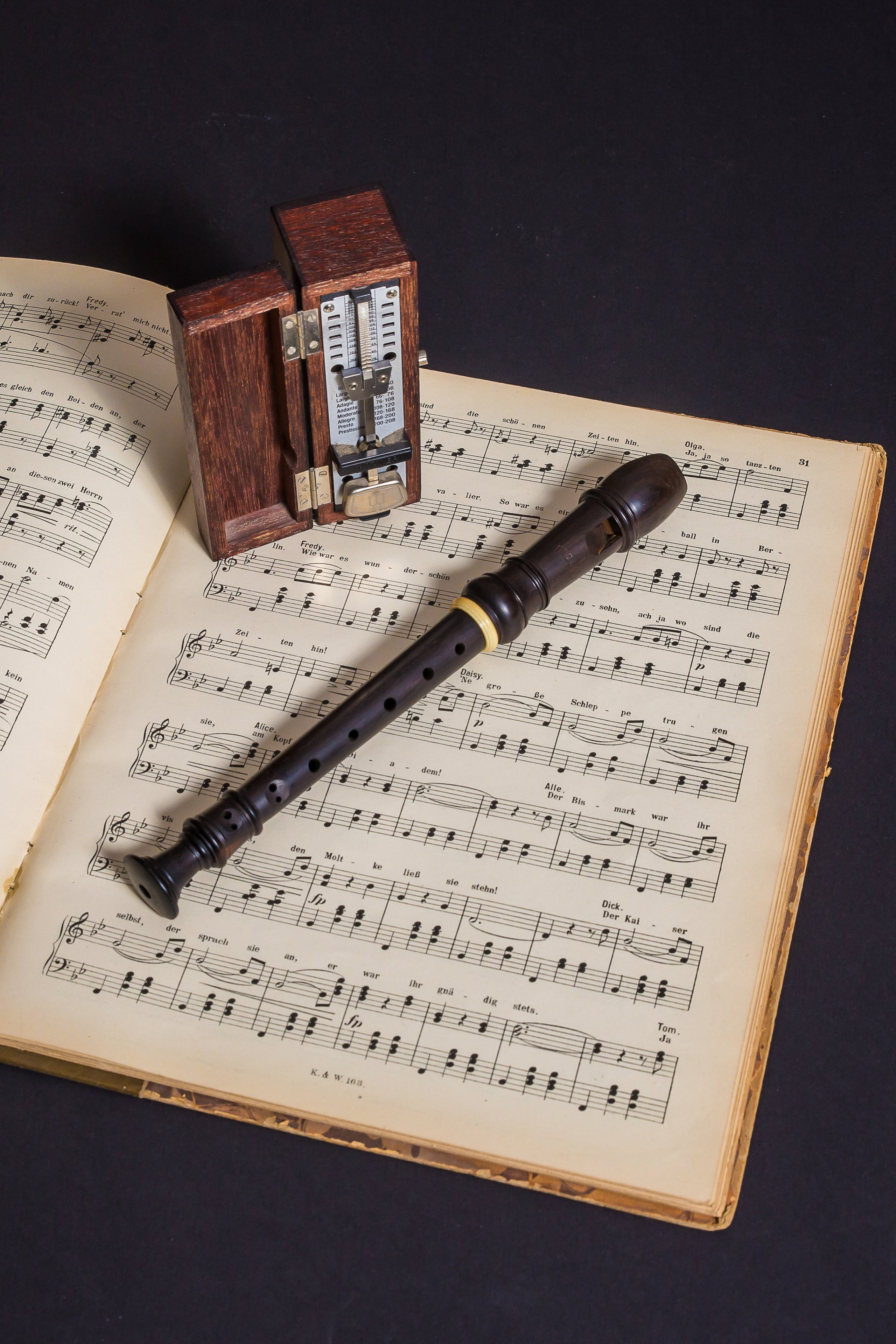 Brown Wooden Flute on Book With Notes