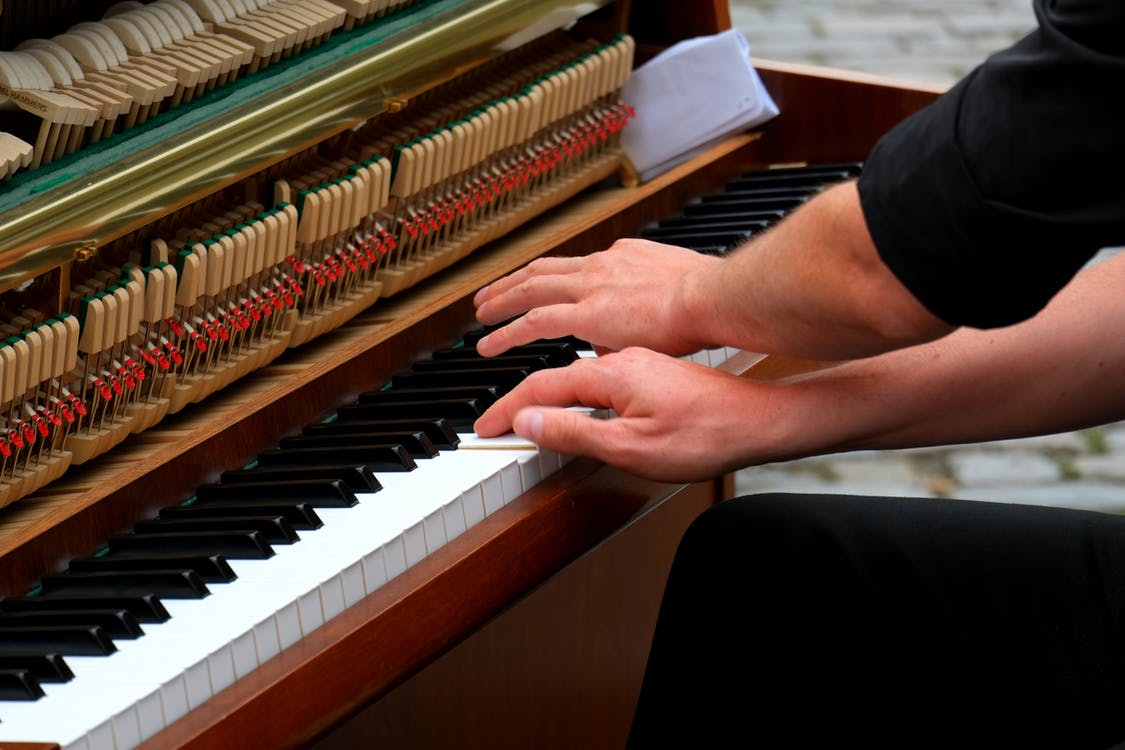 Person Playing Piano Photo