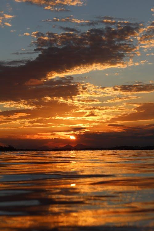 Foto d'estoc gratuïta de alba, capvespre, mar, natura