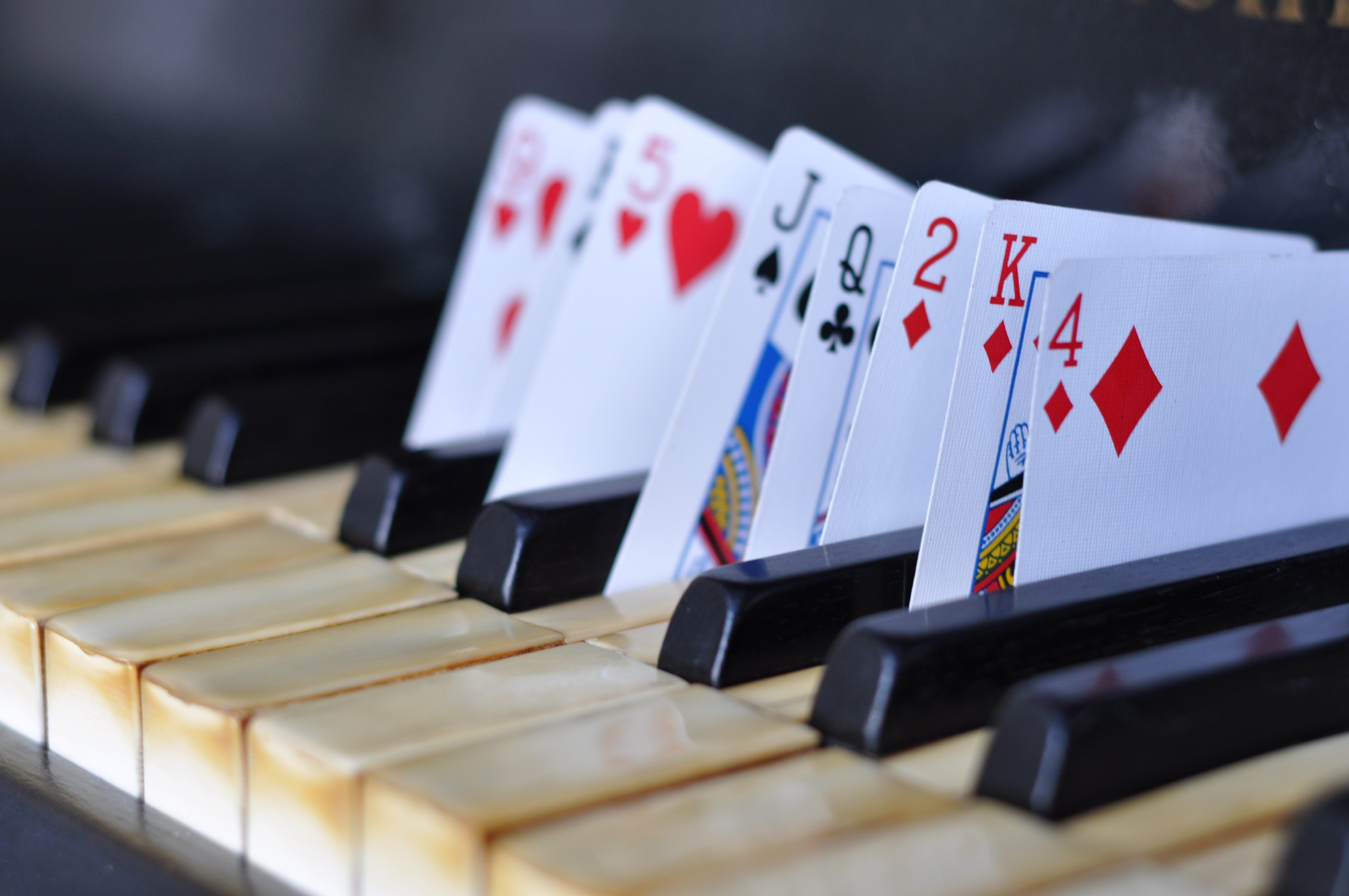 Playing Cards on Piano Keys
