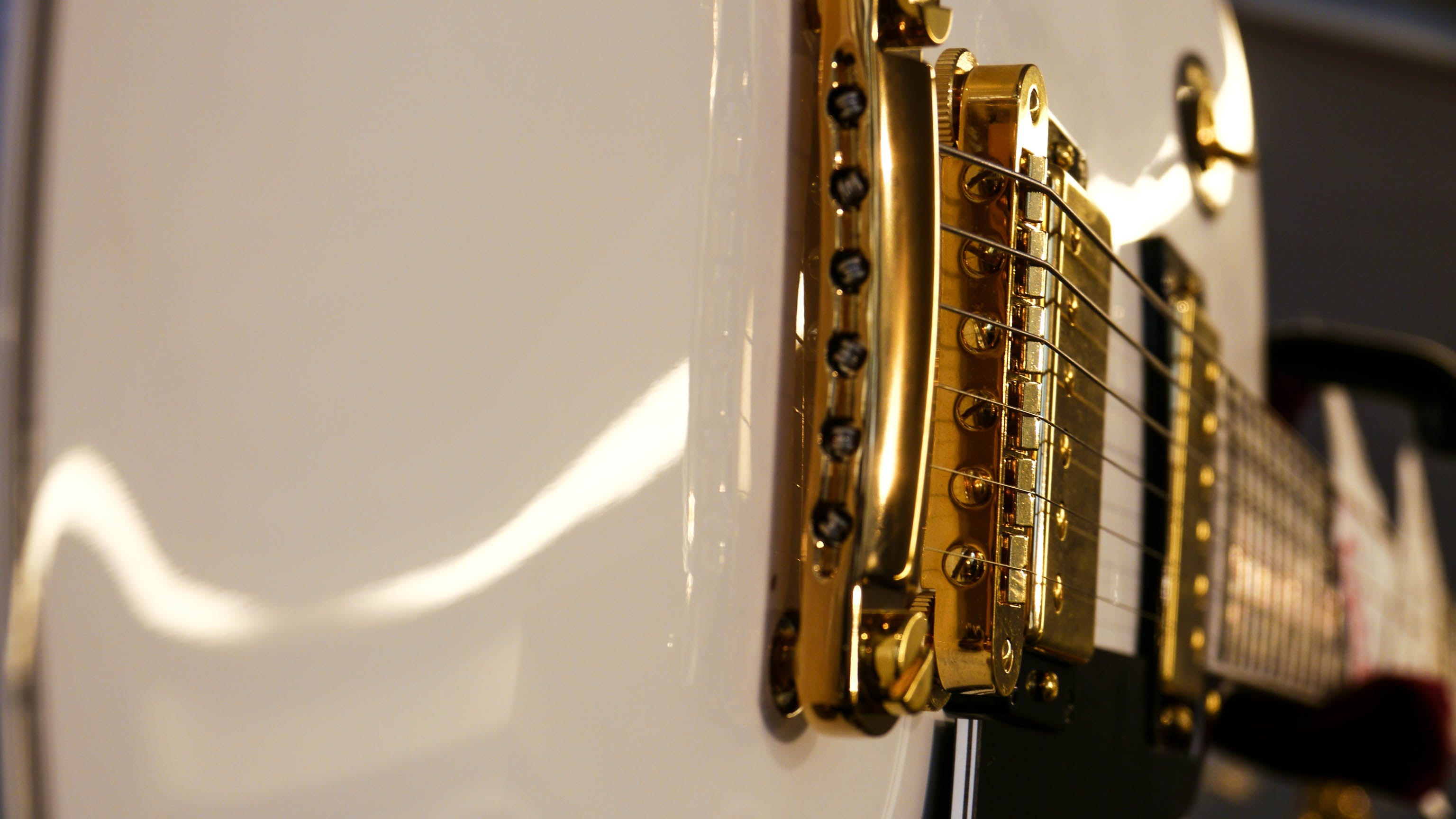 Closeup Photo of White Electric Guitar
