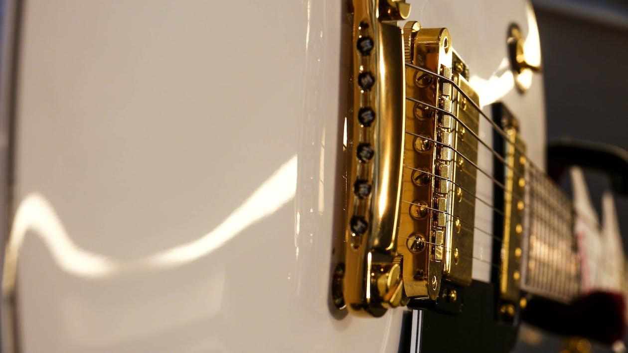Closeup Photo of White Electric Guitar