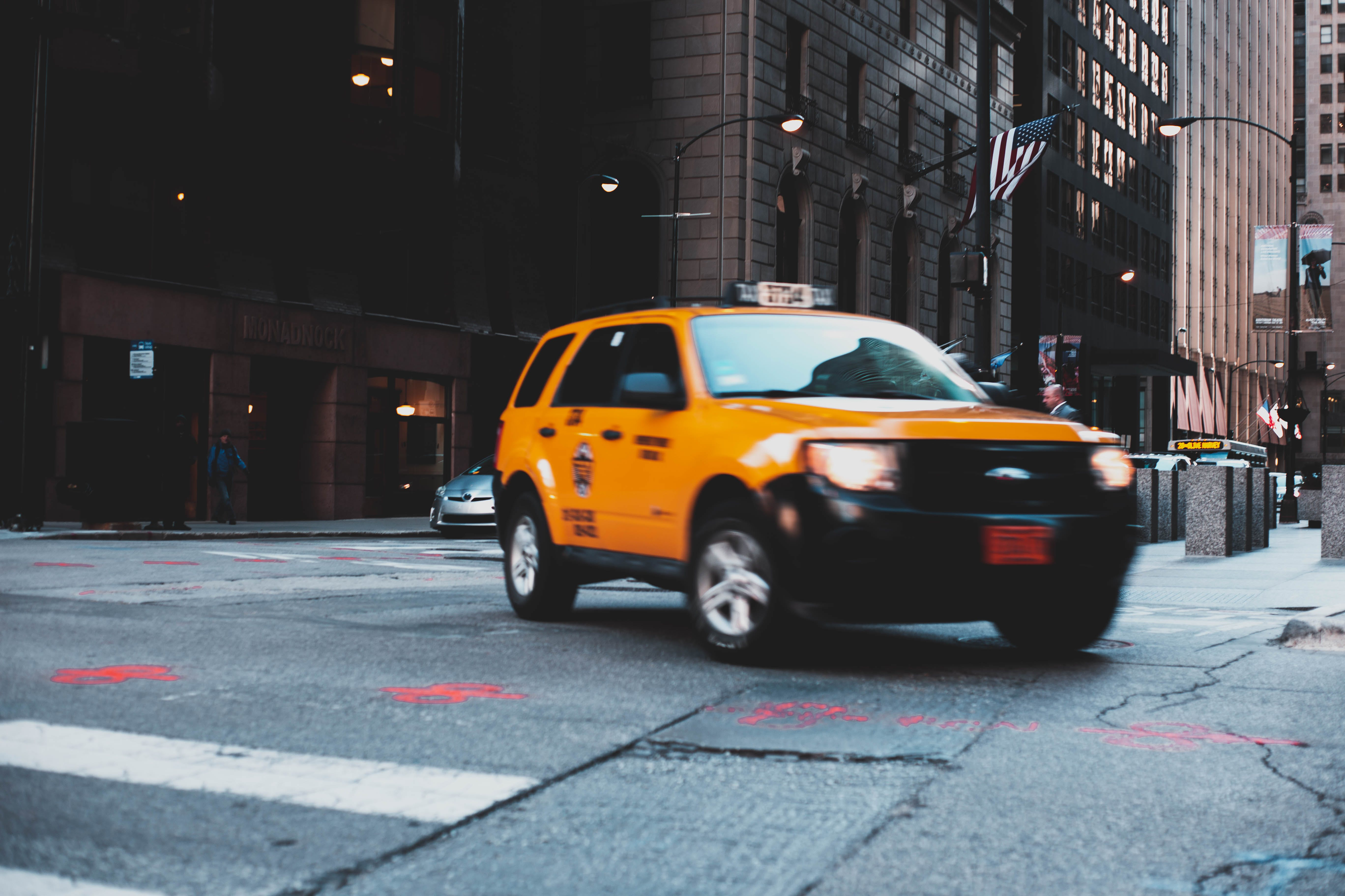 Taxi Making A Turn at the City