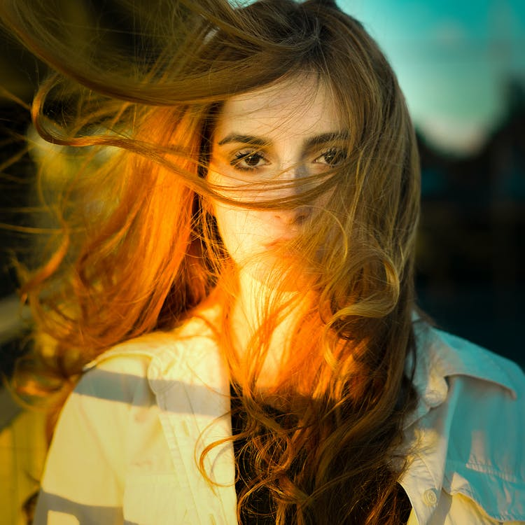Selective Focus Photography Of Woman With Face Covered By Her Hair