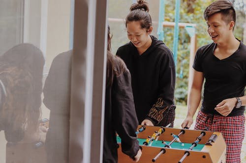 People Playing Foosball Table
