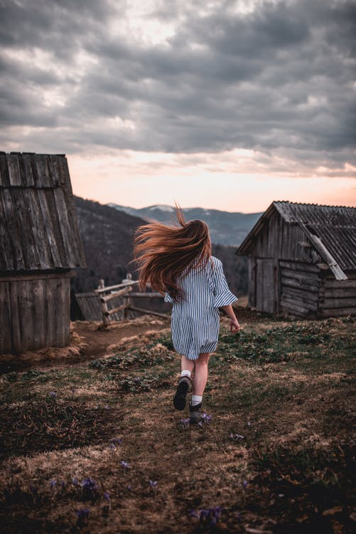 Girl Running on Brown and Green Field