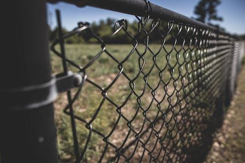 Free stock photo of chain link fence, fences, grey, neighborhood