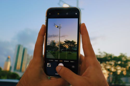 Person Holding Black Smartphone Taking Picture