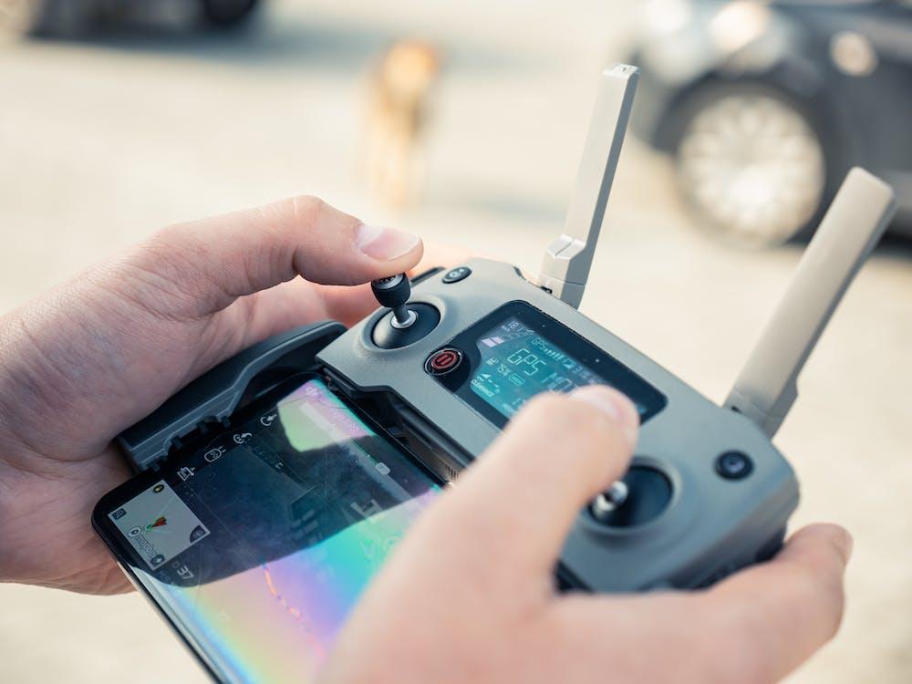 Person Holding Drone Remote
