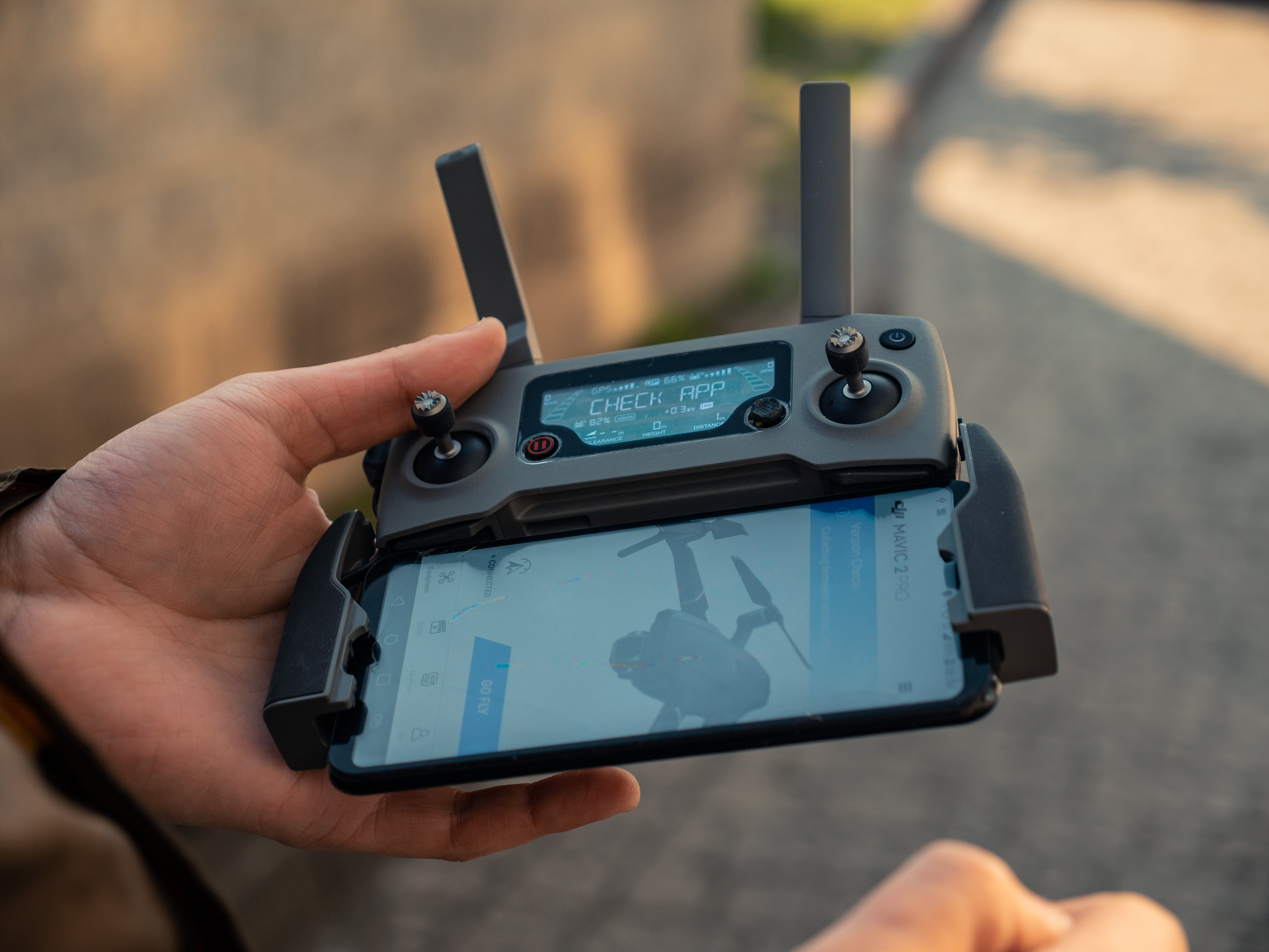 Person Holding Black Drone Controller