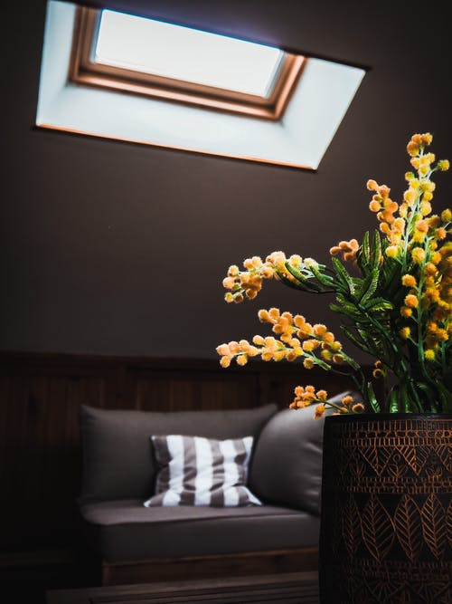 Yellow Petaled Flower Centerpiece In Brown Vase