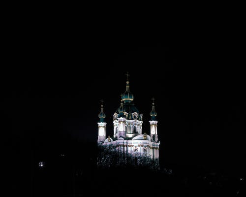 Photography of White and Green Concrete Church during Nighttime