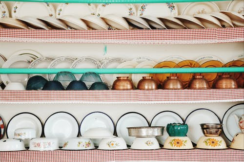 Photo of Tableware Sets on a Rack