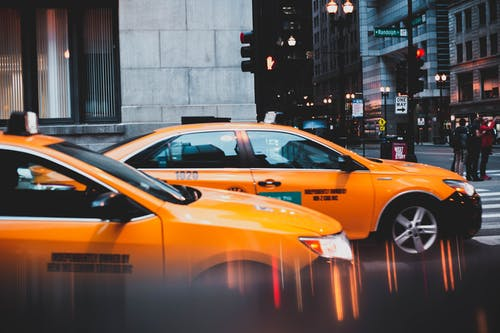 Photo of Two Yellow Cabs