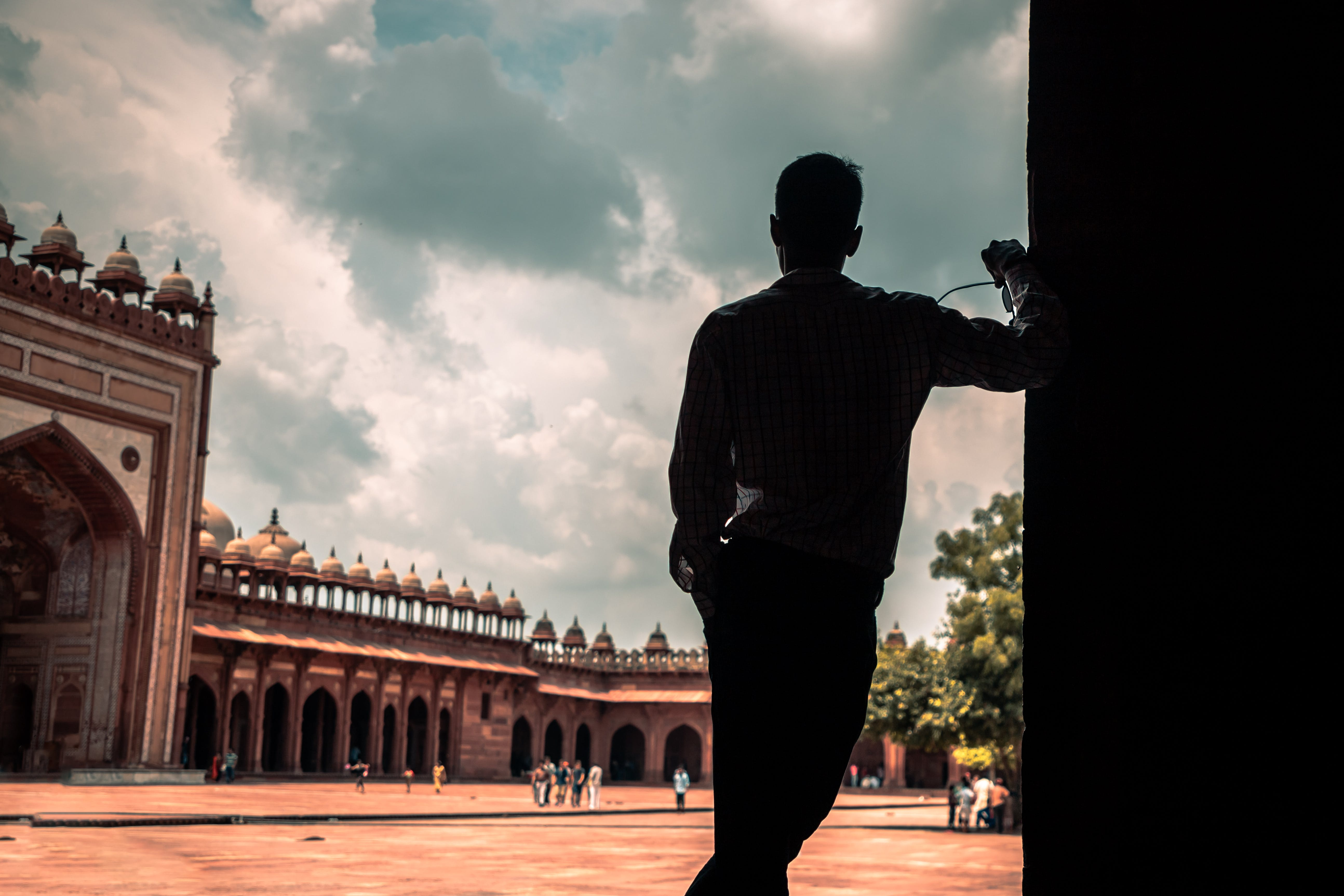 Silhouette of a Man Standing Near Building