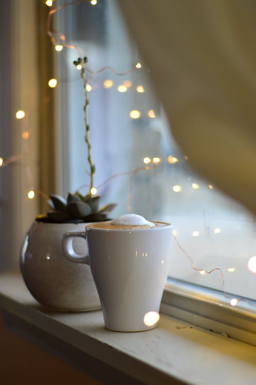 Cup of Cappuccino Near Window
