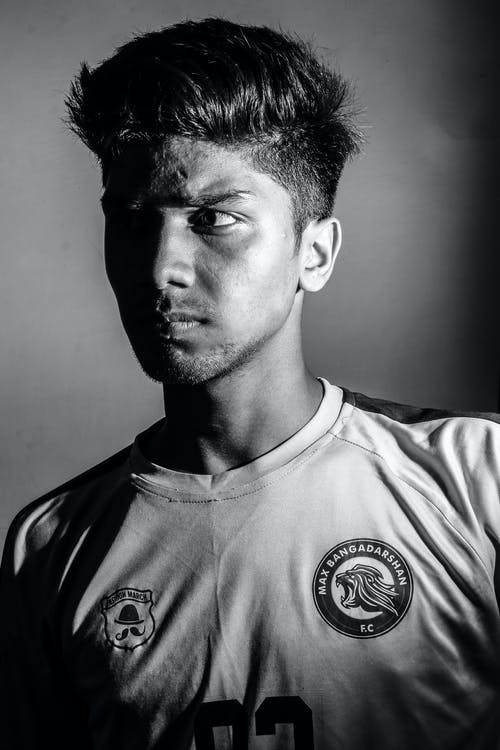 Grayscale Photo of a Man Wearing Jersey Shirt