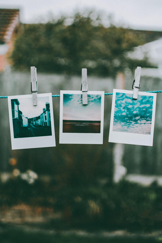 Three Photos Hanged Using Clothes Pin