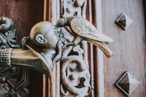 Bird Pricking Man's Head Brass Ornament