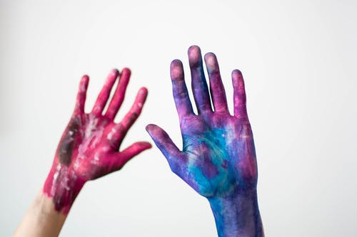Two Hand Filled With Paint