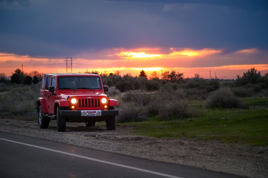 Red Jeep Suv Beside Road