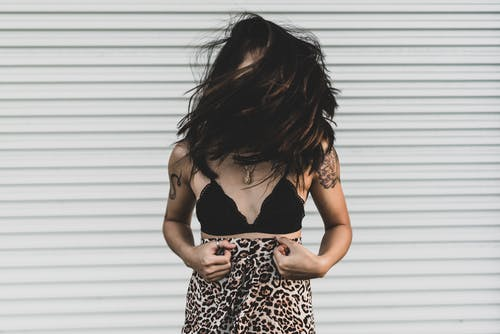 Woman Wearing Black Bra Covering Face With Hair