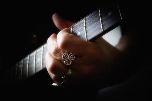 Free stock photo of guitar chord, guitarist, hand on guitar
