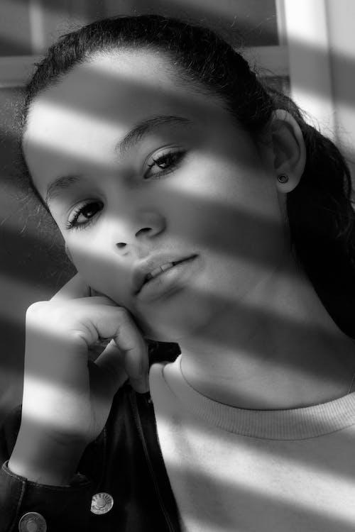 Free stock photo of beautiful girls, black and white, girl in window, roller shutter