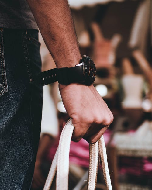 Man Wearing Black Wristwatch on Right Hand Holding Bag