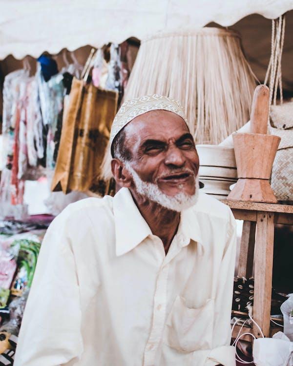 Man Wearing Taqiyah Cap at the Market