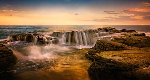 Photos gratuites de aube, bord de mer, cascade, cascades