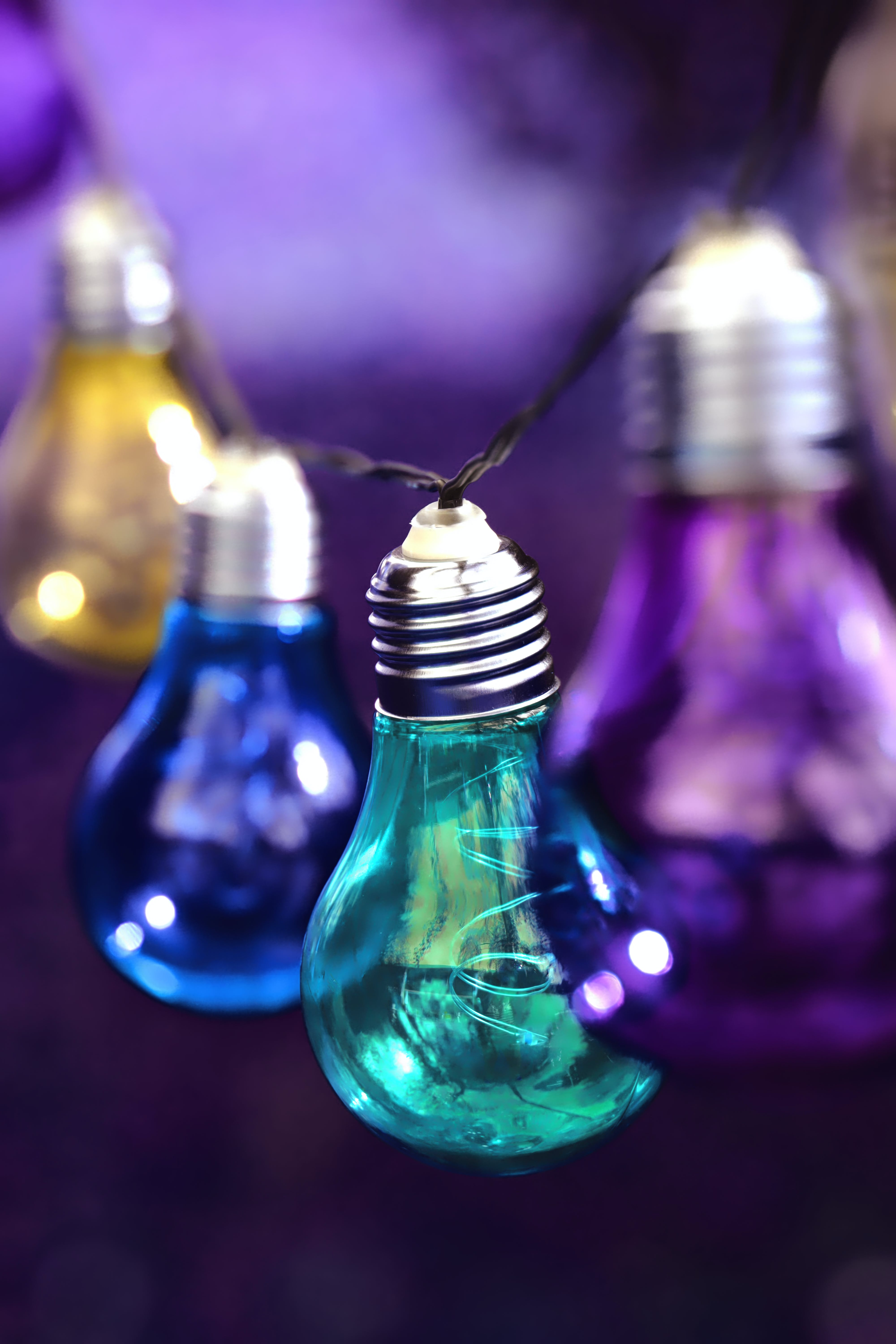 Purple, Teal, Blue, and Yellow Hanging Light Bulbs