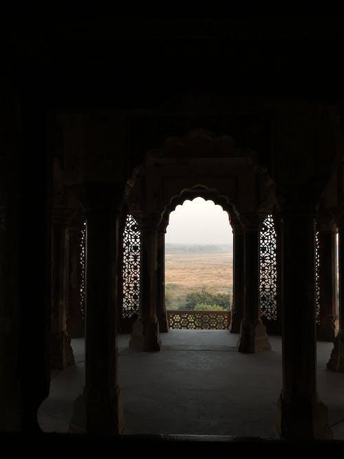 Open Field Through Arch Building