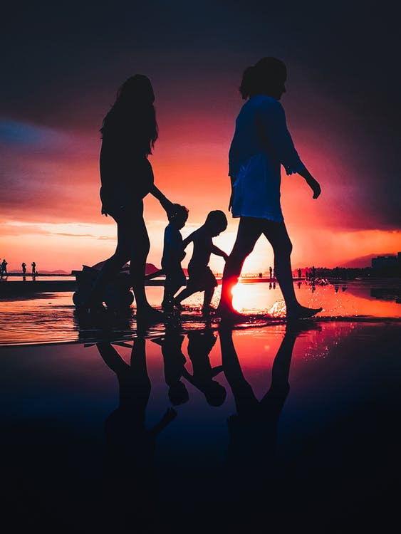 People Walking By Th Beach