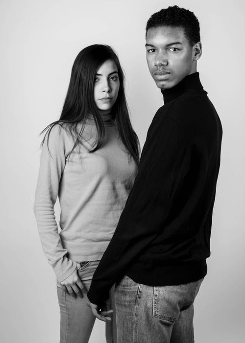 Grayscale Photography of Standing Man and Woman Wearing Turtleneck Long-sleeved Shirts