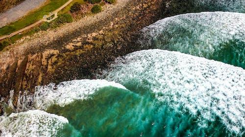 Photos gratuites de accéléré, bord de l'océan, bord de mer, cailloux